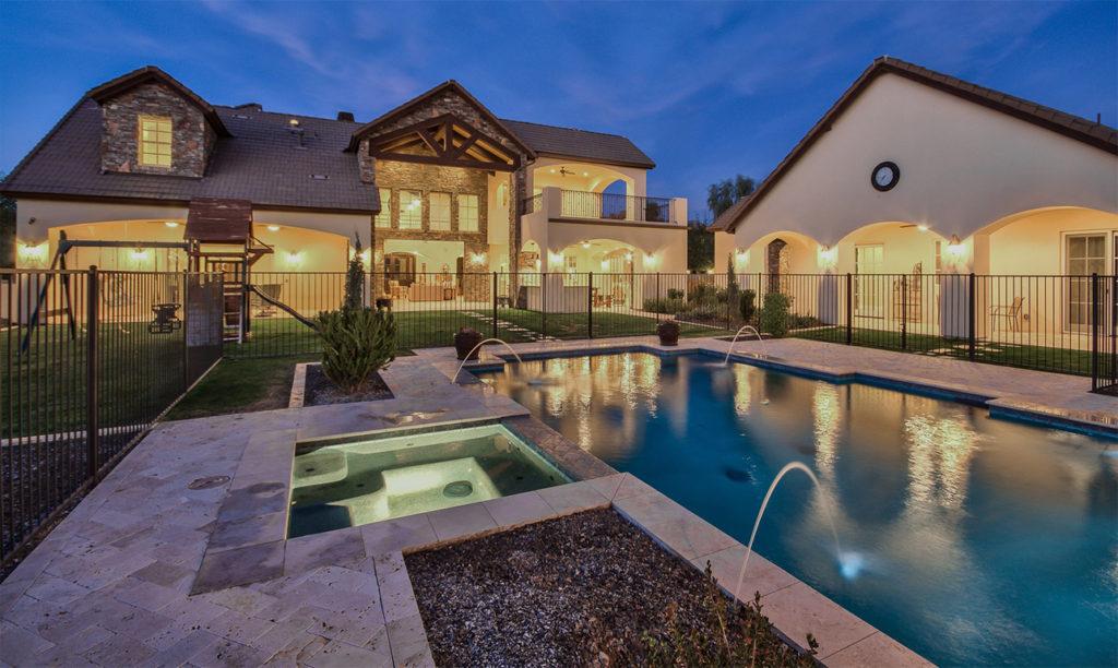 Integrity Luxury Homes in Scottsdale showing beautiful custom pool near custom built house