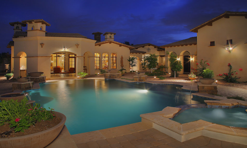 Integrity Luxury Homes in Scottsdale showing custom built home by backyard and pool