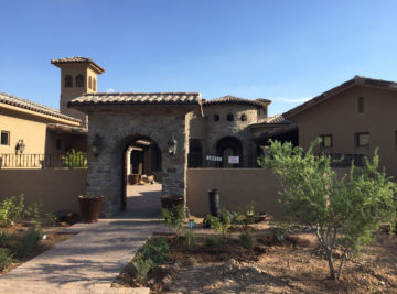 Exterior of classic tuscan custom style home build showing entryway of home with large door